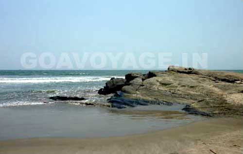 big rock on the shore of Ashwem beach north goa india