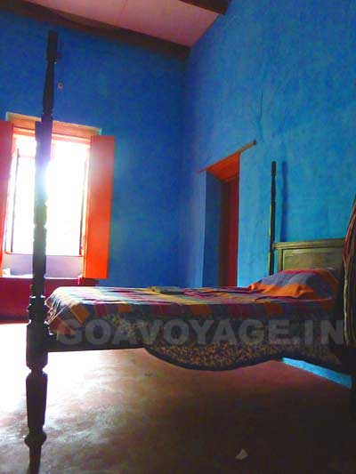 A blue bedroom in an heritage house in South Goa, India