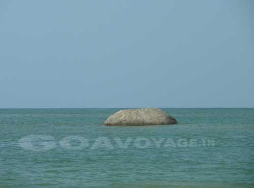 rock in the sea in Palolem beach South Goa, India