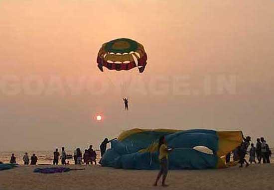 Parasailing at sunset in Colva beach, South Goa, India